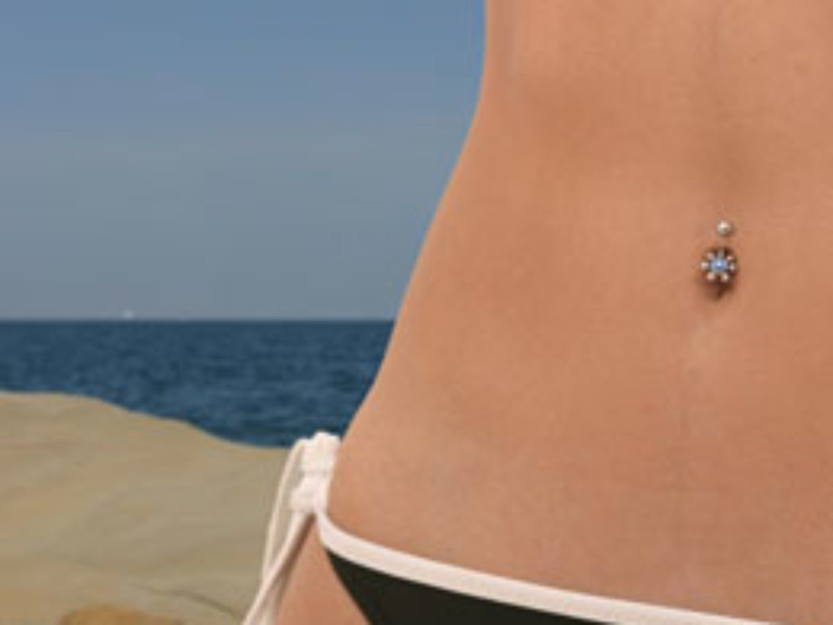 How to Swim After Getting a Belly Button Piercing - Thoughtful Tattoos